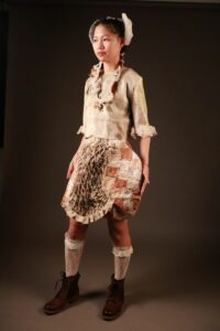 Becky models her garment